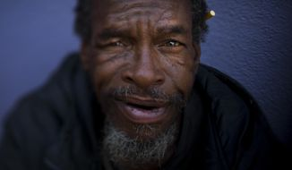 "Moi Williams, 59, poses for a photo Wednesday, Sept. 13, 2017, in Los Angeles. Williams, who has been homeless for four years, said he is comfortable sleeping on the street. ""I'm not bothering nobody. I'm not being bothered."" The homeless are easy to pass by on the street. It's harder when you look into their eyes. Their gazes hint at lost promise or a glimmer of hope. Some are sad, some placid, others haunting. Behind each person is a story that however vague offers some glimpse into their lives. (AP Photo/Jae C. Hong)"