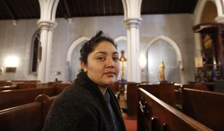 In this Oct. 26, 2017, photo, Amanda Morales, 33, poses for a photograph in the sanctuary of the Holyrood Episcopal Church, the Bronx borough of New York. Morales has been living in two small rooms of the gothic church at the northern edge of Manhattan since August, shortly after immigration authorities ordered her deported to her homeland of Guatemala. (AP Photo/Kathy Willens) ** FILE **