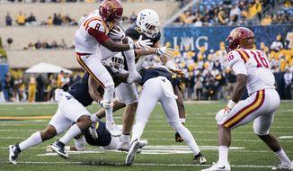 Iowa State wide receiver Deshaunte Jones (8) jumps over West Virginia defenders during the first half of an NCAA college football game in Morgantown, W. Va., Saturday, Nov. 4, 2017. (AP Photo/Walter Scriptunas II) I)