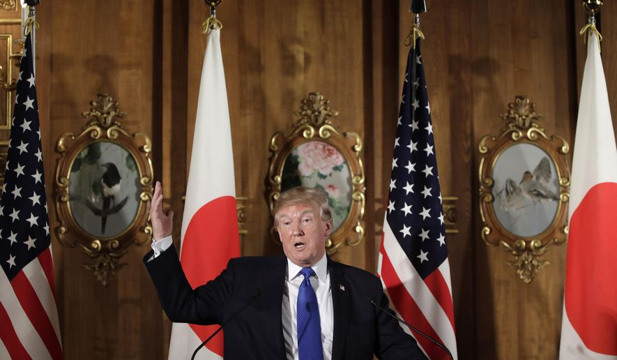 President Donald Trump speaks, accompanied by Japanese Prime Minister Shinzo Abe during a joint news conference at the Akasaka Palace, Monday, Nov. 6, 2017, in Tokyo. Trump is on a five country trip through Asia traveling to Japan, South Korea, China, Vietnam and the Philippines.  (Kiyoshi Ota/Pool Photo via AP)