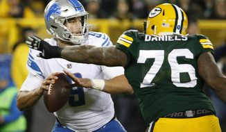 Detroit Lions' Matthew Stafford drops back with Green Bay Packers' Mike Daniels rushing during the first half of an NFL football game Monday, Nov. 6, 2017, in Green Bay, Wis. (AP Photo/Mike Roemer)