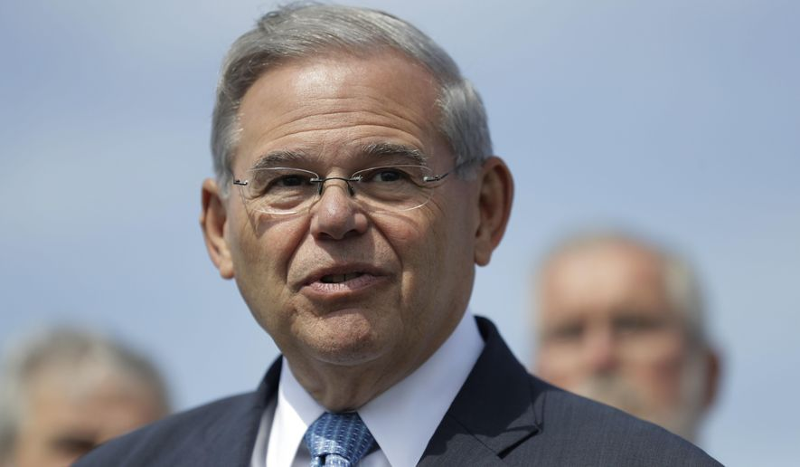 FILE - In this Aug. 17, 2017 file photo, Sen. Bob Menendez, D-N.J., speaks during a news conference, in Union Beach, N.J. A jury could begin deliberations Monday, Nov. 6, in the bribery trial of Menendez and a wealthy friend. (AP Photo/Julio Cortez, File)