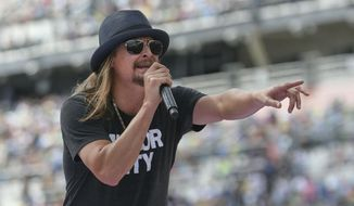 In this Feb. 22, 2015, file photo, singer Kid Rock performs a concert before the Daytona 500 auto race in Daytona Beach, Fla. (AP Photo/Reinhold Matay, File)