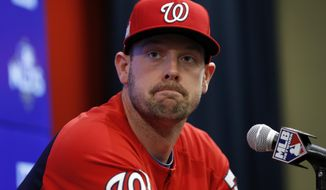 FILE - In this Oct. 12, 2017 file photo, Washington Nationals catcher Matt Wieters listens to a question during a media availability before Game 5 of baseball's National League Division Series against the Chicago Cubs at Nationals Park, in Washington. Wieters is exercising his $10.5 million contract option for next season with the Washington Nationals.  (AP Photo/Alex Brandon)