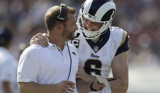 FILE - In this Sept. 10, 2017, file photo, Los Angeles Rams head coach Sean McVay, left, talks with punter Johnny Hekker during the second half of an NFL football game against the Indianapolis Colts, in Los Angeles. With the NFL at the halfway point, plenty of teams have dipped into the playbooks for something special. Johnny Hekker threw a 28-yard pass for a first down on a fake punt by the Rams in Week 2. (AP Photo/Jae C. Hong, File)