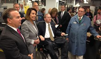 House Democratic leader Nancy Pelosi, second from left, tours a lab at the Community College of Rhode Island, Monday, Nov. 6, 2017, in Warwick, R.I., with Democratic U.S. Reps. David Cicilline, left, and Jim Langevin. Pelosi and the members of Rhode Island's congressional delegation jointly denounced the new Republican tax plan during the college visit, in the hopes of rallying the public against it. (AP Photo/Jennifer McDermott)