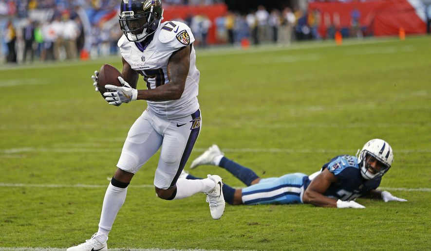 Baltimore Ravens wide receiver Mike Wallace (17) catches a 1-yard touchdown pass ahead of Tennessee Titans defensive back Logan Ryan (26) in the second half of an NFL football game Sunday, Nov. 5, 2017, in Nashville, Tenn. The Titans won 23-20. (AP Photo/Wade Payne)