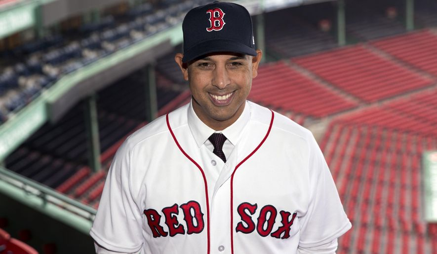 Boston Red Sox new manager Alex Cora poses in Fenway Park following an introductory news conference in Boston, Monday, Nov. 6, 2017. (AP Photo/Michael Dwyer)