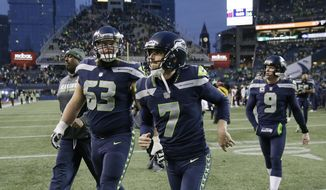 Seattle Seahawks kicker Blair Walsh (7) and offensive guard Mark Glowinski (63) walk off the field after an NFL football game against the Washington Redskins, Sunday, Nov. 5, 2017, in Seattle. Walsh missed on three field goal attempts and the Redskins won 17-14. (AP Photo/Stephen Brashear)
