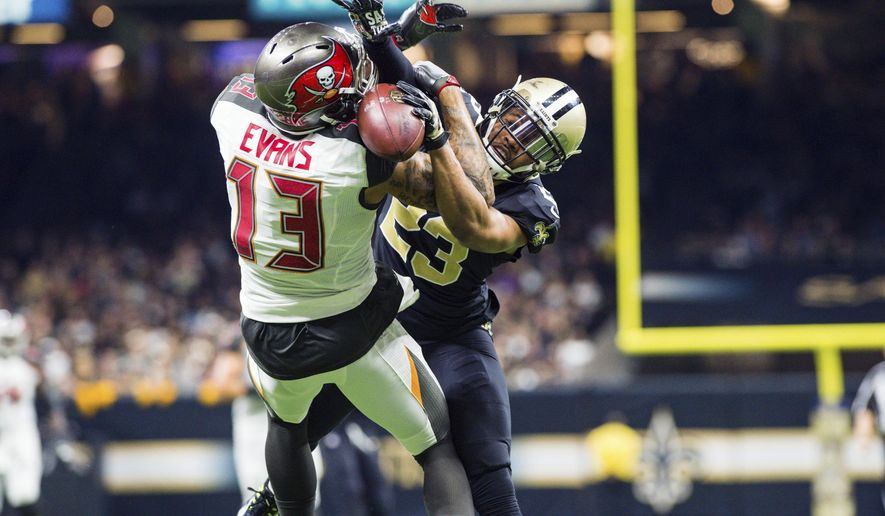 Saints cornerback Marshon Lattimore breaks up a touchdown pass thrown to Buccaneers wide receiver Mike Evans as The New Orleans Saints take on The Tampa Bay Buccaneers in an NFL football game Sunday, Nov. 5, 2017 in Lafayette, La. (Scott Clause/The Daily Advertiser via AP)