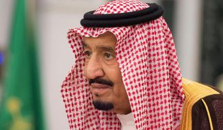 King Salman attends a swearing-in ceremony in Riyadh, Saudi Arabia, Monday, Nov. 6, 2017. (Saudi Press Agency, via AP) ** FILE **