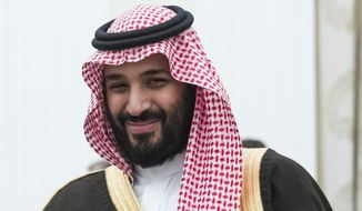 FILE - This May 30, 2017 file photo, shows Saudi Crown Prince and Defense Minister Mohammed bin Salman, (MBS), in Moscow's Kremlin, Russia. The surprise dismissal and arrest of dozens of ministers, royals, officials and senior military officers by MBS late Saturday, Nov. 4, 2017, is unprecedented in the secretive, 85-year-old kingdom. But so is the by-now virtually certain rise to the throne of a 30-something royal who, in another first, is succeeding his father. (AP Photo/Pavel Golovkin, pool, File)