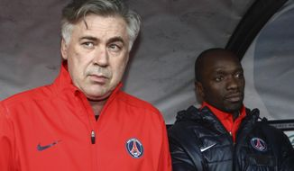 FILE - In this Sunday, Jan. 8, 2012 file photo, Paris Saint Germaine's Italian head coach Carlo Ancelotti, left, and assistant coach Claude Makelele watch their French Cup soccer match against Locmine, in Lorient, western France. Former France midfielder Claude Makelele has ended his 10-month spell as assistant manager at Swansea and has taken over as head coach at Belgian team Eupen, it was announced Monday, Nov. 6, 2017. The 44-year-old Makelele's only other role as a head coach was at French club Bastia, where he lasted six months before getting fired. He has also been an assistant at Paris Saint-Germain (AP Photo/David Vincent, file)