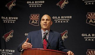 FILE - In this July 13, 2017, file photo, Rick Tocchet, the new coach of the Arizona Coyotes, speaks during a news conference in Glendale, Ariz. Tocchet will get his third Pittsburgh Penguins Stanley Cup ring, second as an assistant coach after one as a player, when he visits as coach of the Arizona Coyotes on Tuesday night, Nov. 7, 2017. (AP Photo/Ross D. Franklin, File)