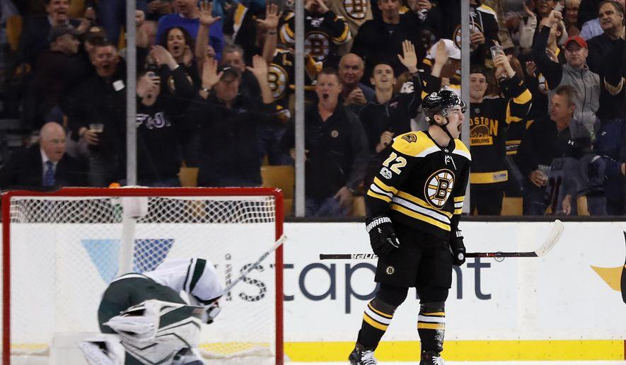 Boston Bruins' Frank Vatrano celebrates his goal on Minnesota Wild goalie Devan Dubnyk during the first period of an NHL hockey game in Boston Monday, Nov. 6, 2017. (AP Photo/Winslow Townson)
