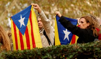 Years of propaganda and relentless campaigning by secessionist politicians who have controlled the regional government in Spain's wealthy northeastern corner have generated ethnic resentment and mutual suspicions that are tearing away at Catalonia's social fiber, according to local citizens from all walks of life who spoke to The Washington Times. (Associated Press/File)