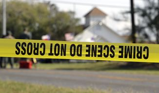 Law enforcement officials continue to investigate the scene of a shooting at the First Baptist Church of Sutherland Springs, Tuesday, Nov. 7, 2017, in Sutherland Springs, Texas. A man opened fire inside the church in the small South Texas community on Sunday, killing and wounding many. (AP Photo/Eric Gay)