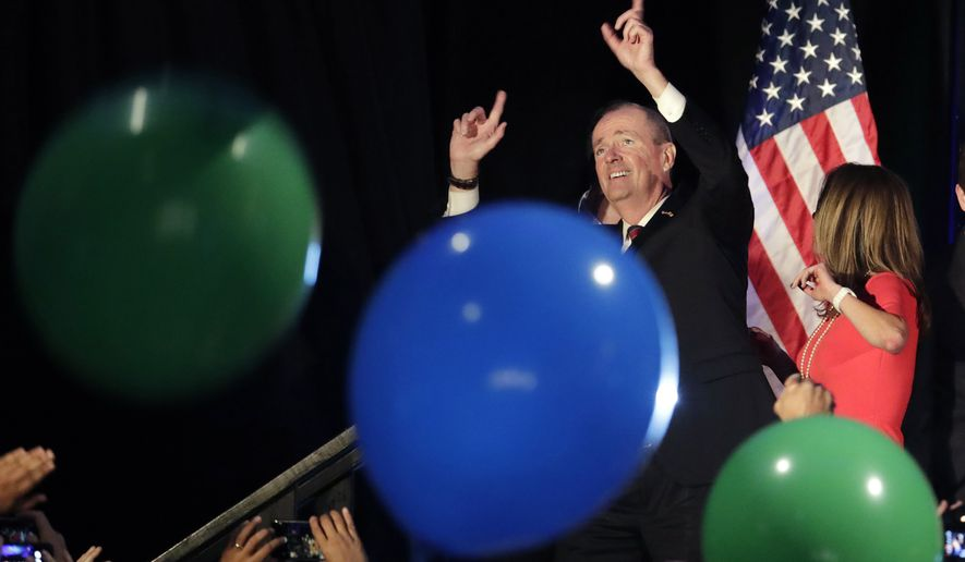 New Jersey gubernatorial nominee Phil Murphy reacts as balloons drop during his election night victory party at the Asbury Park Convention Hall, Tuesday, Nov. 7, 2017, in Asbury Park, N.J. (AP Photo/Julio Cortez)