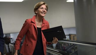 Sen. Elizabeth Warren, D-Mass., walks to vote on Capitol Hill in Washington, Tuesday, Nov. 7, 2017. (AP Photo/Susan Walsh)