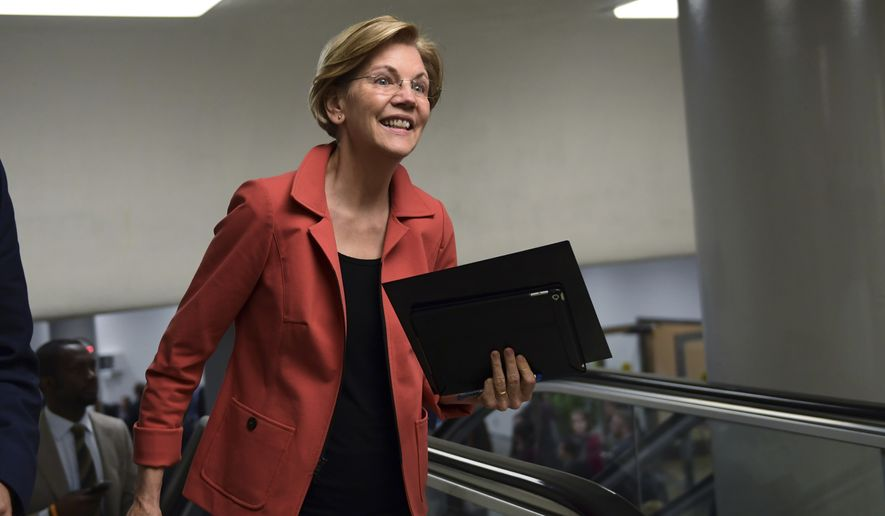 Sen. Elizabeth Warren, D-Mass., walks to vote on Capitol Hill in Washington, Tuesday, Nov. 7, 2017. (AP Photo/Susan Walsh)