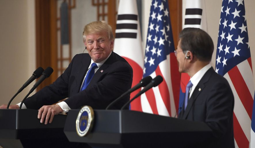 U.S. President Donald Trump, left, smiles with South Korean President Moon Jae-In during a joint press conference at the presidential Blue House in Seoul, South Korea, Tuesday, Nov. 7, 2017. (Jung Yeon-Je/Pool Photo via AP) ** FILE **
