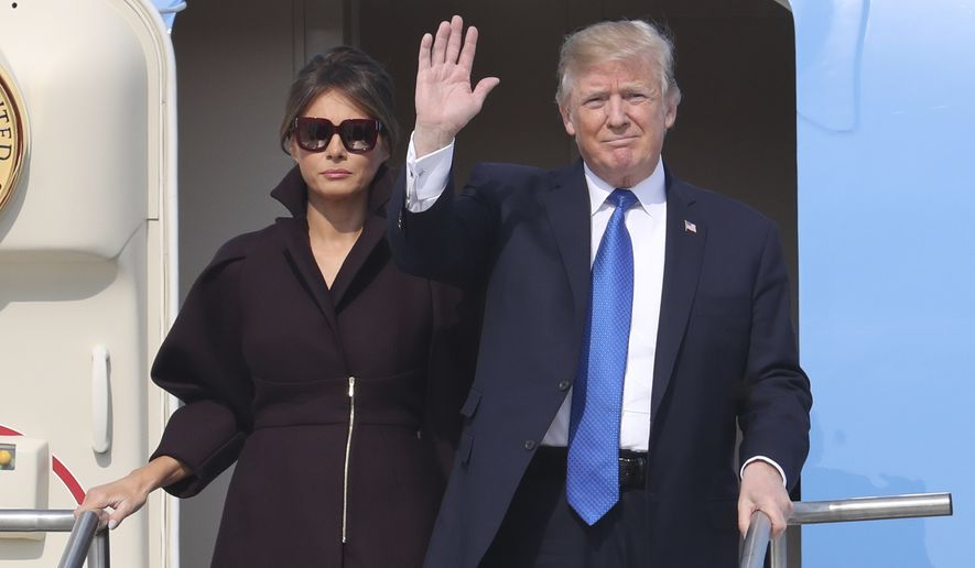 In this Tuesday, Nov. 7, 2017, file photo, U.S. President Donald Trump, right, and first lady Melania Trump arrive at Osan Air Base in Pyeongtaek, South Korea. (AP Photo/Lee Jin-man, File)