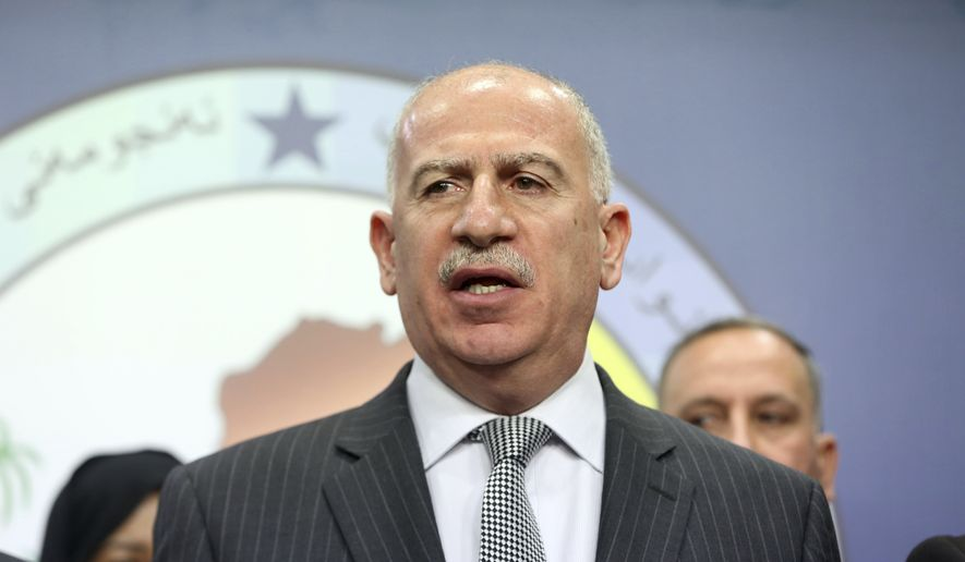 In this July 13, 2014, file photo, Iraqi former Parliament speaker and the chairman of the Sunni Arab coalition Osama al-Nujaifi, speaks to the media during a news conference in Baghdad, Iraq. Iraq's highest-ranking Sunni is in Washington pleading for military aid for his community's militias, hoping the U.S. will deliver on pledges to counter Iran's growing influence. Osama al-Nujaifi is one of three Iraqi vice presidents and his brother heads a prominent defense faction. (AP Photo/Karim Kadim, File)