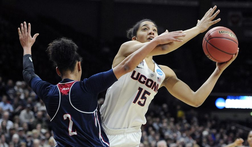 FILE - In this March 21, 2016, file photo, Connecticut's Gabby Williams, right, shoots against Duquesne's Deva'Nyar Workman (2) during the first half of a second round of a women's college basketball game in the NCAA Tournament in Storrs, Conn. Williams was selected to The Associated Press preseason All-America team on Tuesday, Nov. 7, 2017. (AP Photo/Jessica Hill, File)