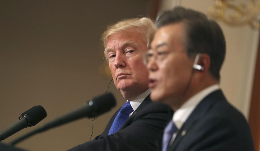 President Donald Trump, left, listens to South Korean President Moon Jae-in during a joint news conference at the Blue House in Seoul, South Korea, Tuesday, Nov. 7, 2017. (AP Photo/Andrew Harnik) ** FILE **