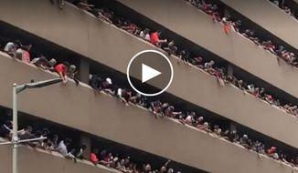 Astros fans toss up woman's lost baseball cap in parking garage, floor by floor (Credit: Twitter/Josh Pherigo via Storyful)