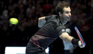 Andy Murray makes a backhand return in action against Roger Federer, in their friendly singles match during the Andy Murray Live Event at the SSE Hydro in Glasgow, Scotland, Tuesday Nov. 7, 2017. (Jane Barlow/PA via AP)