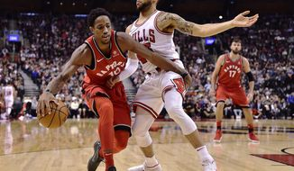 Toronto Raptors guard DeMar DeRozan (10) tries to get past Chicago Bulls forward Denzel Valentine (45) during the first half of an NBA basketball game, Tuesday, Nov. 7, 2017 in Toronto. (Frank Gunn/The Canadian Press via AP)