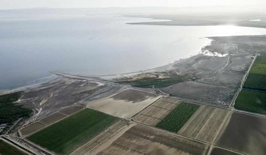 FILE - This May 1, 2015 file photo shows the exposed lake bed of the Salton Sea drying out near Niland, Calif. California regulators Tuesday, Nov. 7, 2017, approved a plan to spend nearly $400 million over 10 years to slow the shrinking of the state's largest lake, a major resting place for migratory birds and a buffer against swirling dust in farming towns. (AP Photo/Gregory Bull, File)