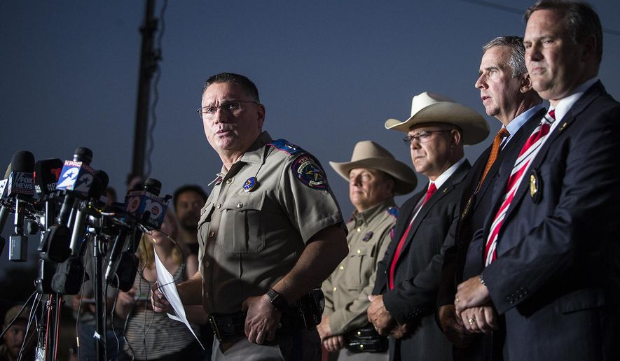 Texas Department of Public Safety Regional Director Freeman Martin provides information to media members about the fatal shooting at the First Baptist Church in Sutherland Springs, on Monday, Nov. 6, 2017. (Nick Wagner/Austin American-Statesman via AP)