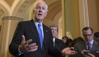 Majority Whip John Cornyn, R-Texas, joined at right by Sen. Roy Blunt, R-Mo., answers a question about the mass shooting at a Texas church this week, during a news conference on Capitol Hill in Washington, Tuesday, Nov. 7, 2017. (AP Photo/J. Scott Applewhite) **FILE**
