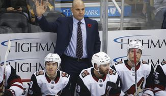 Arizona Coyotes coach Rick Tocchet acknowledges fans after a video tribute honoring his days as a player and coach for the Pittsburgh Penguins during a timeout in the first period of an NHL hockey game between the Coyotes and the Penguins, in Pittsburgh, Tuesday, Nov. 7, 2017. (AP Photo/Gene J. Puskar)
