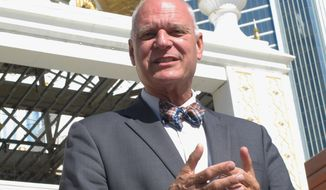 This Oct. 17, 2017 photo shows Don Guardian, the Republican incumbent mayor of Atlantic City NJ discussing the election in front of the former Trump Taj Mahal casino on his city's Boardwalk. Atlantic City voters will choose their next mayor on Tuesday, Nov. 7. (AP Photo/Wayne Parry)