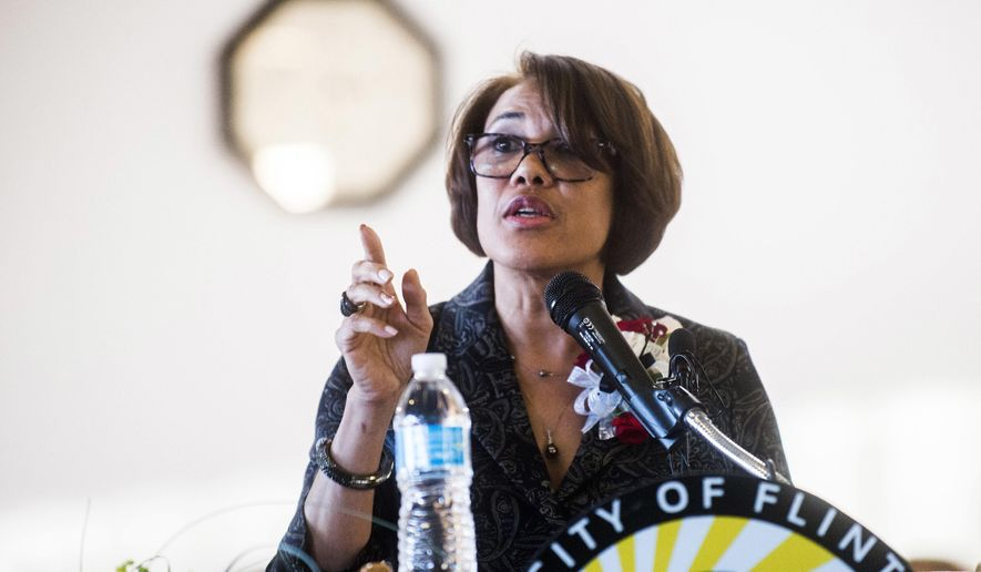 FILE - In this Oct. 17, 2017, file photo, Flint Mayor Karen Weaver delivers a State of the City address in Flint, Mich. Flint voters go to the polls Nov. 7, 2017 to decide whether to recall Weaver on a ballot that includes her name and 17 other candidates. (Jake May/The Flint Journal-MLive.com via AP, File)