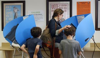 Locals cast their ballots in Georgia's general election on the last day of early voting in Athens, Ga., Friday, Nov. 3, 2017. (Joshua L. Jones/Athens Banner-Herald via AP)