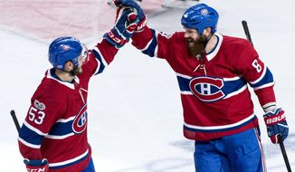 Montreal Canadiens' Jordie Benn, right, celebrates his goal with teammate Victor Mete as they face the Vegas Golden Knights during the first period of an NHL hockey game, Tuesday, Nov. 7, 2017, in Montreal. (Paul Chiasson/The Canadian Press via AP)