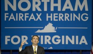 Virginia Democratic Gov. elect Ralph Northam addresses supporters at the Northam For Governor election night party at George Mason University in Fairfax, Va., Tuesday, Nov. 7, 2017. Northam defeated Republican Ed Gillespie. (AP Photo/Cliff Owen)