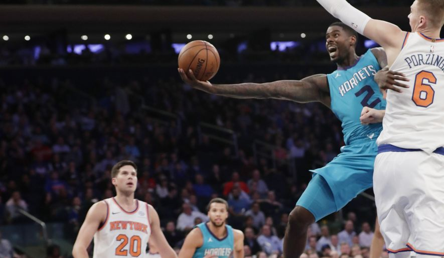 Charlotte Hornets' Marvin Williams (2) drives past New York Knicks' Kristaps Porzingis (6) during the first half of an NBA basketball game Tuesday, Nov. 7, 2017, in New York. (AP Photo/Frank Franklin II)