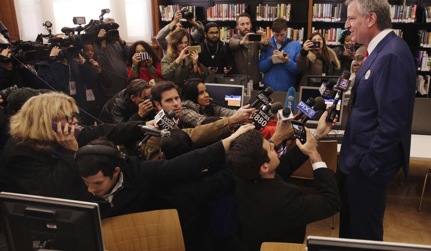 New York Mayor Bill de Blasio, and wife Chirlane McCray, meet the press after voting at the Park Slope Library, in the Brooklyn borough of New York, Tuesday, Nov. 7, 2017. De Blasio is seeking his second term leading the nation's largest city. (AP Photo/Richard Drew)