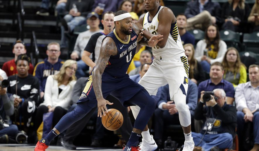 New Orleans Pelicans center DeMarcus Cousins (0) drives on Indiana Pacers center Myles Turner (33) during the second half of an NBA basketball game in Indianapolis, Tuesday, Nov. 7, 2017. The Pelicans defeated the Pacers 117-112. (AP Photo/Michael Conroy)