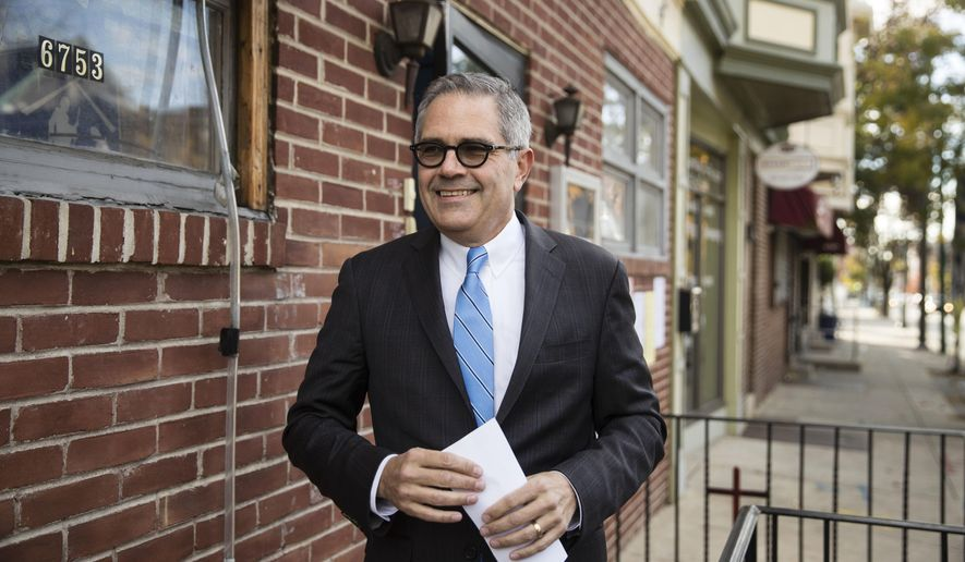 Democratic nominee for Philadelphia district attorney Larry Krasner walks from his polling place after voting in Philadelphia, Tuesday, Nov. 7, 2017. His opponent is Republican Beth Grossman. (AP Photo/Matt Rourke)