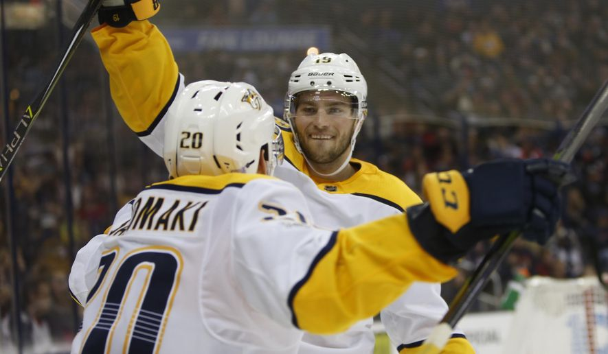 Nashville Predators' Calle Jarnkrok, of Sweden, celebrates his goal against the Columbus Blue Jackets during the third period of an NHL hockey game Tuesday, Nov. 7, 2017, in Columbus, Ohio. The Predators won 3-1. (AP Photo/Jay LaPrete)