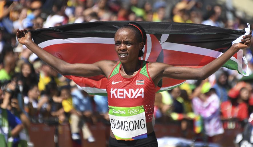 FILE - This is a  Sunday, Aug. 14, 2016  file photo of Kenya's Jemima Sumgong as she celebrates winning the women's marathon during the Summer Olympics athletics event in Rio de Janeiro, Brazil. Olympic marathon champion Jemima Sumgong of Kenya on Tuesday Nov. 7, 2017 was banned four years for using the banned blood-booster EPO. Sumgong's ban was announced by the Anti-Doping Agency of Kenya. The agency ruled her ineligible from April 3 this year. The gold medalist at the Rio de Janeiro Games failed an out-of-competition doping test on Feb. 28. (Johannes Eisele/Pool Photo via AP)