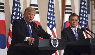 U.S. President Donald Trump, left, speaks as South Korean President Moon Jae-In listens during a joint press conference at the presidential Blue House in Seoul, South Korea, Tuesday, Nov. 7, 2017. (Jung Yeon-Je/Pool Photo via AP) ** FILE **
