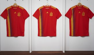 In this undated image, the Spain jersey that will be used in the World Cup. The jersey, that has the colors red, yellow and blue, has sparked controversy after being linked to the Republican flag of the 1930s. (Jose F. Vallejo/Adidas via AP).