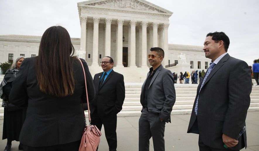 James Nye, far right, spokesman for the Gun Lake Tribe, arrives at the Supreme Court with members of the Gun Lake tribal council, Tuesday, Nov. 7, 2017, in Washington. The Supreme Court is taking up a dispute that arose out of the building of a casino by a Native American tribe in Michigan, who were sued by David Patchak in 2008 after the Match-E-Be-Nash-She-Wish Band of Pottawatomi Indians, also known as the Gun Lake Tribe, got the go ahead to build a casino on land in Wayland, Michigan, near where he lives. (AP Photo/Jacquelyn Martin)